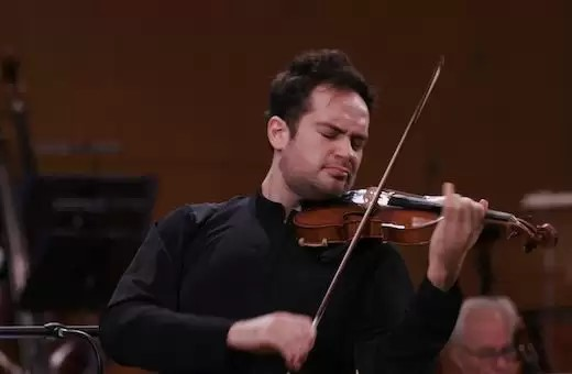 Mark Bouchkov's exceptionally powerful performance of the Sibelius Violin Concerto focused on the music's sweep and majesty
